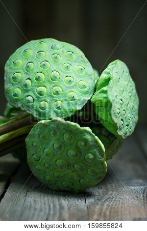 Calyx, Lotus Seeds Green On Wood Background
