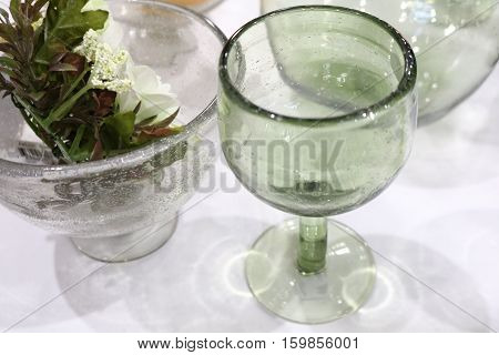 glass goblet with a jug on the table
