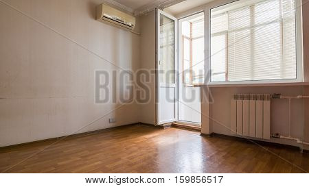 Interior Of An Empty Room, A Balcony And A View Of The Portion Of The Wall