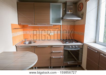 The interior of an the empty kitchen