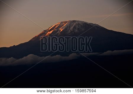 Stunning evening view of Kibo with Uhuru Peak (5895m amsl, highest mountain in Africa) at Mount Kilimanjaro,Kilimanjaro National Park