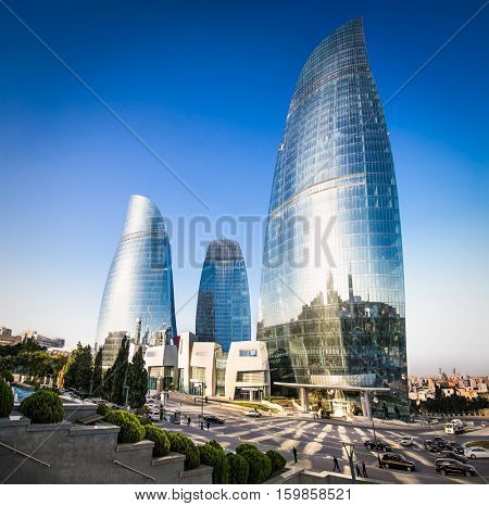 BAKU, AZERBAIJAN -OCT 4, 2016: Flame Towers skyscraper on sunset in Baku, Oct 4, 2016,  Azerbaijan. The Flame Towers is the tallest skyscraper in Baku, with a height of 190 m.