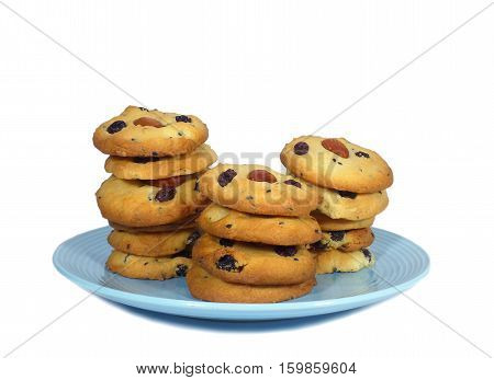 Close-up of almond raisin butter cookies piled up on a plate Isolated on White Background