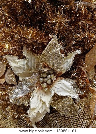 Embellished Christmas tree decoration gold flower and tinsel
