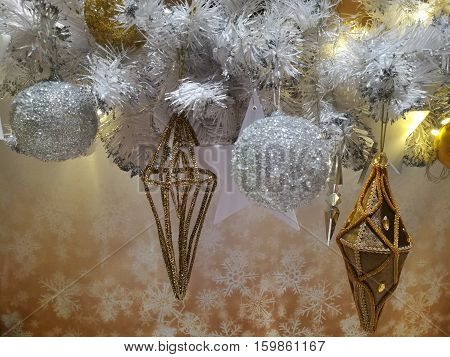 Embellished Christmas tree decoration gold ornament frosted hanging ball star and white tinsel