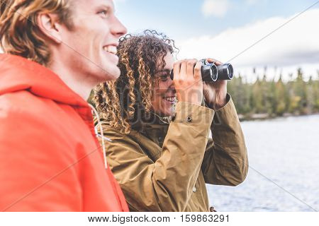 Woman And Man Looking Through A Binoculars