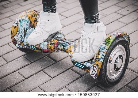 Electriic hyroscooter driving. Person self balancing hoverboard. Driving giroscooter.