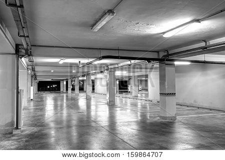 Underground garage. Empty underground parking (black and white)