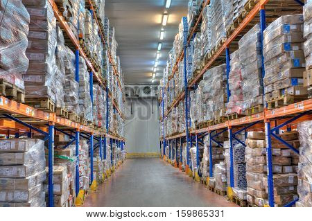 Saint-Petersburg Russia - October 31 2016: Shelves and racks in distribution cold storage warehouse interior.