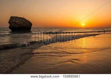 Matalascañas. Sunset in the beach Matalascañas, Huelva, Spain