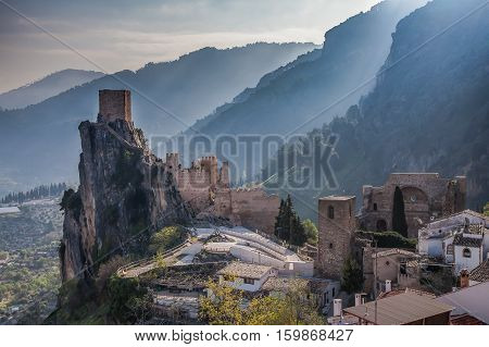 Castle  La Iruela located in the Sierra de Cazorla in the region of Andalusia, Spain. The castle posse a tower that is located at the top of a mountain of natural stone.                                                                       Dawn in the cas