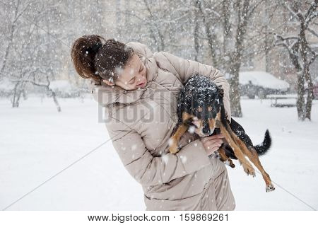 Smiling Girl With Dog In Winter Snow