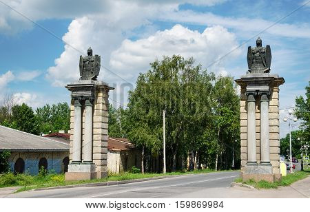 Smolensk gates Gatchina Russia. Armor with helmet shield and sword crowned pylon 1830s construction of the year.
