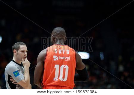 VALENCIA, SPAIN - DECEMBER 3: 10 Sato and Referee during spanish league match between Valencia Basket and Bilbao Basket at Fonteta Stadium on December 3, 2016 in Valencia, Spain