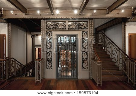 Large decorative elevator with ornated doors closeup