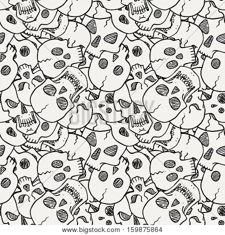 Vector seamless pattern with random skulls. Scary design.