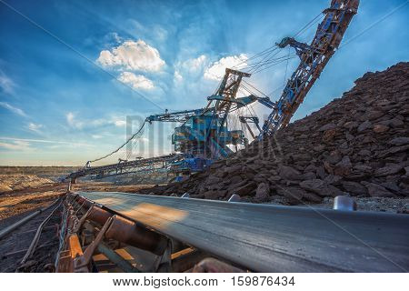 Long conveyor belt transporting ore to the power plant poster