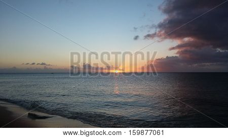 Sunset with clouds over the ocean. Turks and caicos islands.
