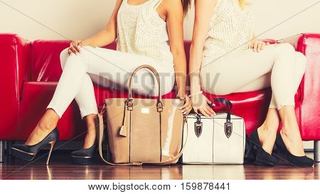 Fashionable Girls With Bags Handbags On Red Couch