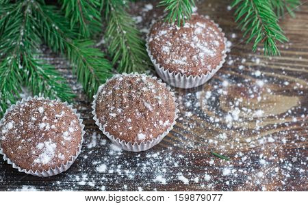 Three Christmas Cakes, Winter Snowbound Wooden Background, Fir Tree Branches