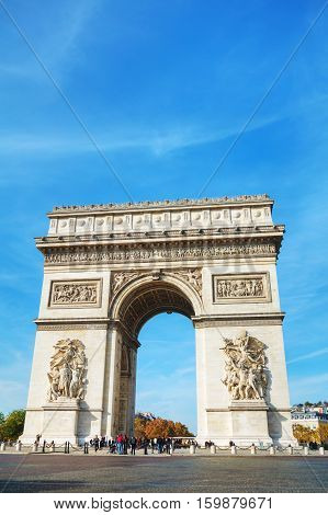 PARIS - NOVEMBER 1: The Arc de Triomphe de l'Etoile on November 1 2016 in Paris France. It's one of the most famous monuments in Paris and stands in the centre of the Place Charles de Gaulle.