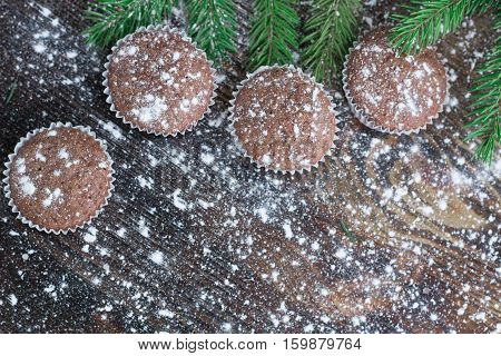 Four Christmas Cakes On Winter Snowbound Wooden Background, Fir Tree