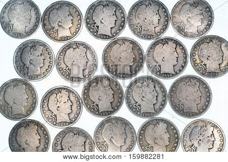 A group of old silver Barber Half Dollars.