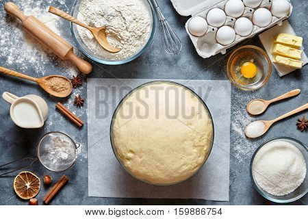 Dough preparation recipe bread, pizza or pie making ingridients, food flat lay on kitchen table background. Working with butter, milk, yeast, flour, eggs, sugar pastry or bakery cooking.
