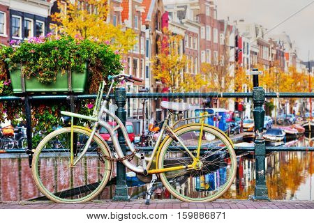 Bycicle parked at the bridge in Amsterdam