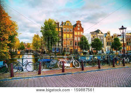 Amsterdam city view with canals and bridges in the evening