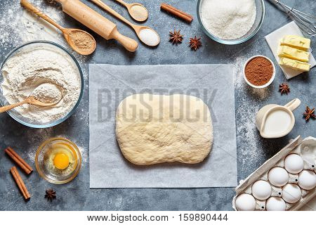 Dough preparation recipe homemade traditional bread, pizza or pie ingridients, food flat lay on kitchen table background. Working with butter, milk, yeast, flour, eggs, sugar pastry or bakery cooking