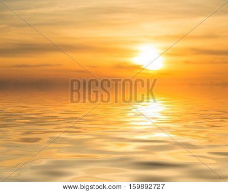 Sunset Over Calm Ocean Or Sea