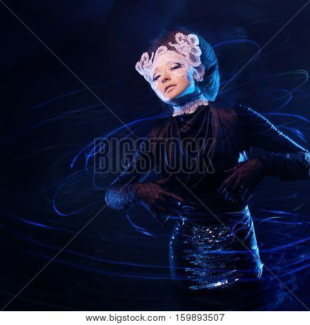 The model in the center of a glowing vortex of stars, galaxies concept, art blurred image