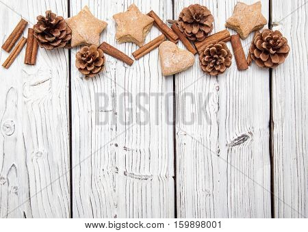 Christmas pine cone decoration on white wooden texture board