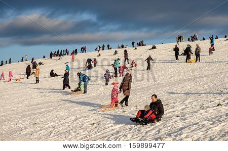 Riga Latvia - December 4 2016 - Snow sledding hill in Riga is joy for children and adults. This weekend first opening for public by Nil Ushakov the mayor of the city