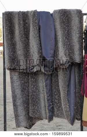 foreground of a fur coat of medieval era on a coat rack