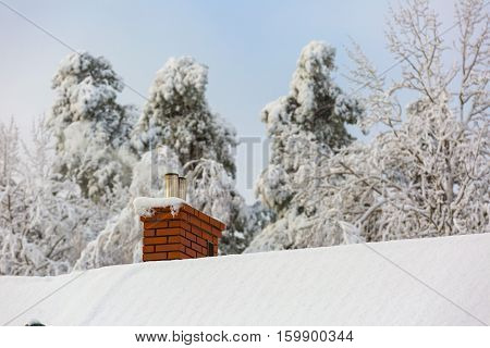 House Roof With Chimney At Snowy Winter Day