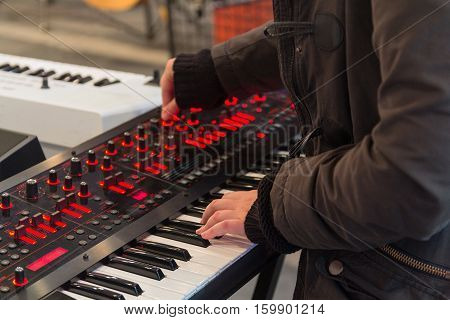 Herb musician playing the synthesizer. Musical instruments