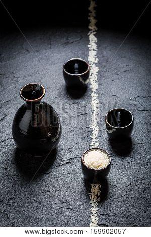 Enjoy Your Sake In Black Ceramics On Black Rock