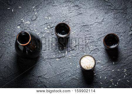 Strong Sake In Black Ceramics On Black Rock