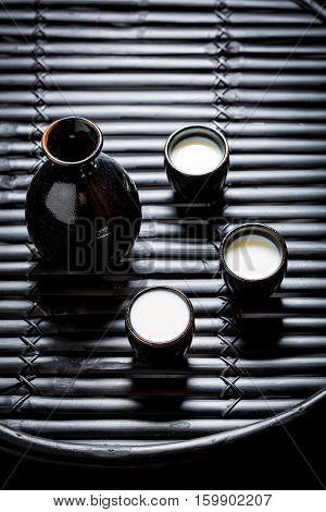 Prepared To Drink Sake In Black Ceramics On Black Table