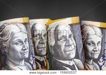 Australian money background.  Fifty dollar notes against dark background.