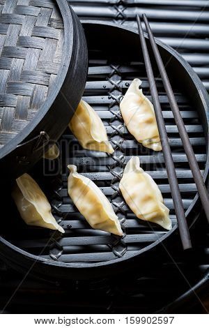 Tasty And Hot Chinese Dumplings In Wooden Steamer