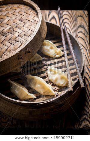Delicious And Hot Gyoza Dumplings In Wooden Steamer