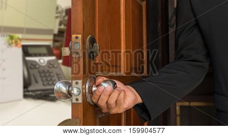 businessman open door to office blur background - can use to display or montage on product