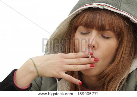 young woman lighting cigarette isolated on white background  close up. concept of nicotine addiction by teenagers
