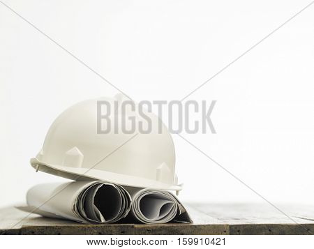 white hard hat with blue prints
