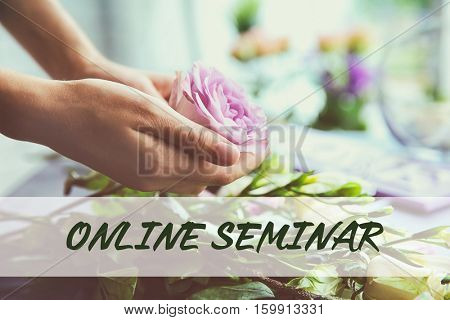 Female florist with flower, closeup. Text ONLINE SEMINAR on background. Florist and floral design tutorial concept.