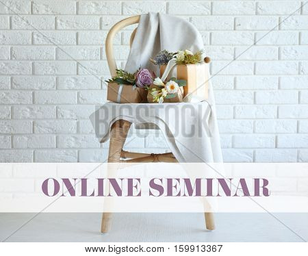 Gift boxes decorated with flowers on chair. Text ONLINE SEMINAR on background. Florist and floral design tutorial concept.