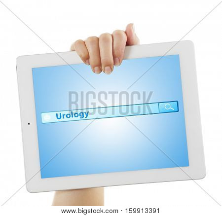 Female hand with tablet on white background. Word UROLOGY at search engine. Health care concept.